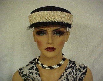 SALE.  Black linen pill box hat with wide curly white band - has face veil- and adornment