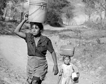 Carrying Water, Photojournalistic view of a Mother and Daughter in Nicaragua, Central America
