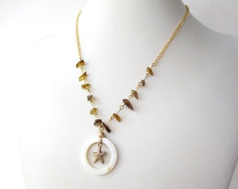 Starfish necklace with white MOP hoop, golden starfish charm, amber glass and vintage gold plated chain
