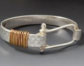 Sterling silver and gold basket weave clasp bracelet