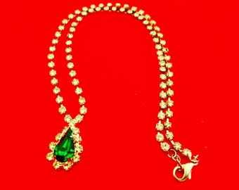 "Vintage art deco silver tone 16.5"" necklace with clear rhinestones and center emerald green stone in great condition"