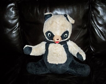 large very old stuffed panda bear