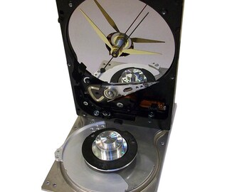Hard Drive Clock Accented with Disk Spindle and Disk Separator Assembly on Shiny Base.