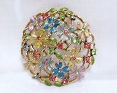 Vintage  Monet  Enamel  and Rhinestone Flower Bouquet  Pin Brooch Pink Purple Yellow Blue and Green set in Goldtone