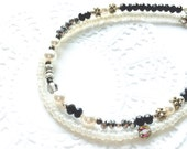 Dainty two strand friendship bracelet. Delicate bracelet for layering or stacking up.