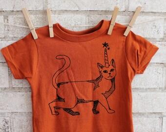 Cat With Unicorn Horn Children's T shirt, Cotton Crewneck Graphic Tee in RUST Orange ,Caticorn tShirt, Screenprinted by hand, fantasy animal