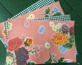 Reversible provincial salmon and dark green oilcloth placemats