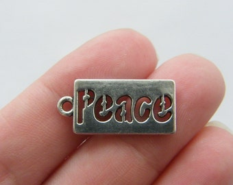 BULK 50 peace charms antique silver tone M118