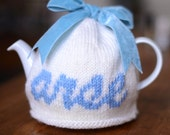 "Rude ""arse"" cream and blue wool tea cosy"