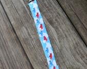 Ribbon Pacifier Clip- Red and Blue Airplanes