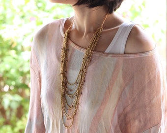 Layered Nine Strand Nude Woven Necklace