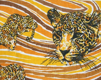 Vintage Kay Dee linen towel with leopards or cheetahs. Big cats, groovy, retro, orange, yellow, caramel.