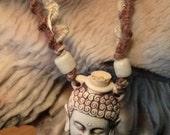 Buddha ceramic perfume oil bottle  hemp necklace made by Christine H. Rietsch