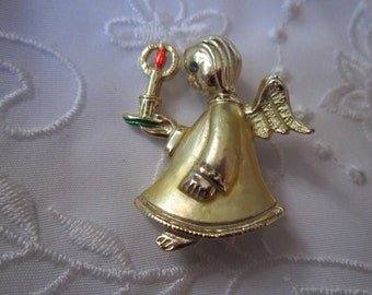 Vintage Gold Tone Christmas Angel Brooch with A Candle and Blue Rhinestoned Eye