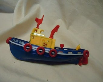 Vintage Plastic Toy Wind Up Police  Boat,  Red, white, yellow and blue collectable