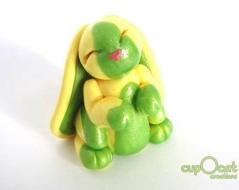 Happy Little Bunny - A Yellow and Green Bunny Fairy Figure
