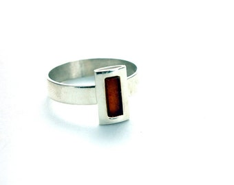 small ring of brandy colored amber set in sterling silver, sizes: 6, 7.5, 8, 9