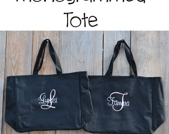 Set of eight monogrammed totes