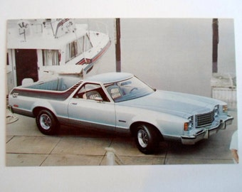 Vintage 1977 Ranchero GT Dealer Advertising Postcard with blue car  automobile and boat