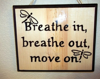 Stress relief sign breathe in breathe out move on