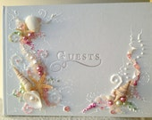 """Beach wedding guest book, hand decorated with real starfish and sea shells in pink and white with a touch of green, 8.5""""x 6""""or 10""""x11"""""""