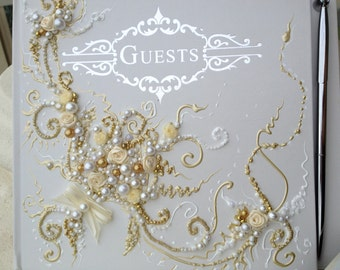 """Beautiful Wedding guest book in gold, white and ivory, 10""""x11"""" with a pen attached or 6""""x8.5"""", hand decorated with roses and pearls"""