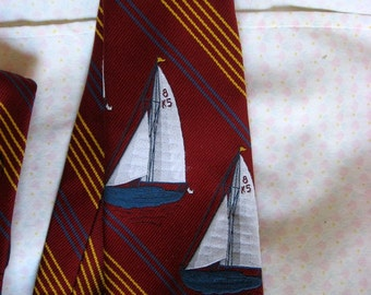 Vintage tie w two sail boats on cranberry baclgound  1970s polyester woven in switzerland