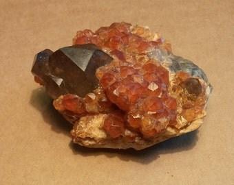Spessartite and Smoky quartz specimen