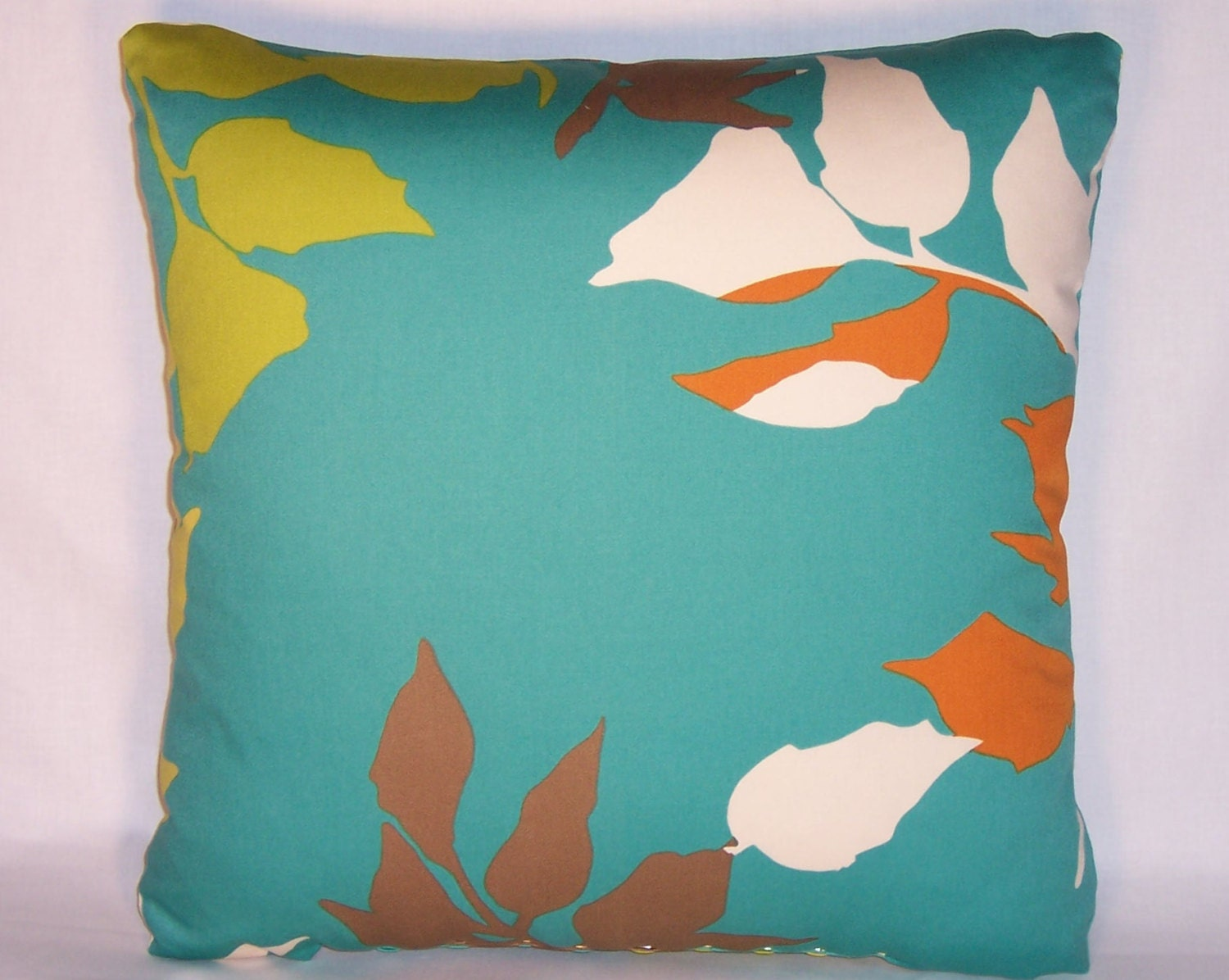 turquoise leaves throw pillow with lime orange brown and. Black Bedroom Furniture Sets. Home Design Ideas