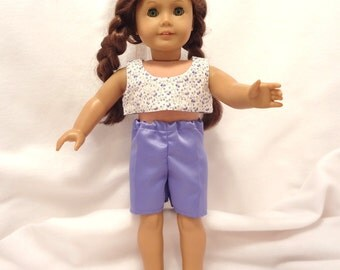 Shorts and halter for 18 inch dolls.  Purple floral on white halter and purple shorts.