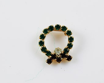 Vintage Dark Green and Red and Gold Tone Wreath Brooch with Faux Diamond