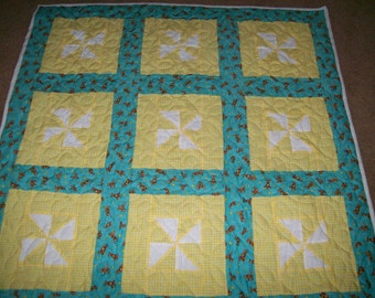 Crib Quilt in Pinwheel pattern with Teddy Bear Sashing and Backing