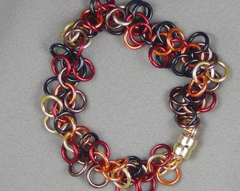 "Random mix of Yellow, Orange, Red, Brown, and Black Anodized Aluminum Rings, Bracelet - 7.25"" - Hand Crafted Artisan Jewelry"