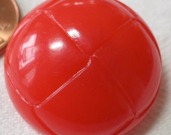 Red plastic domed buttons with self shank. 1 inch across, Imitation folded top. 4 available. UNK13.11-11.10.