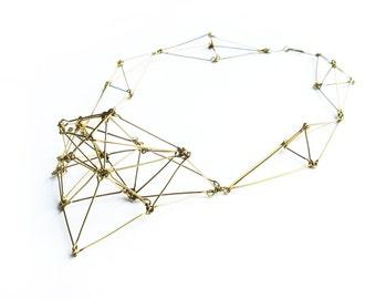 Geometric bib necklace made of golden brass wire statement jewelry Futuristika
