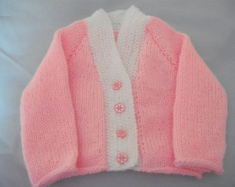hand knitted baby sweater 0 to 3 months in pink and white