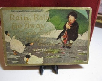 1914 antique COLGATE children's advertising booklet Rain, Rain, Go Away and other mother goose melodies with ads for cashmere talcum