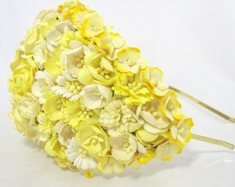 Bright yellow flower Floral headpiece. For wedding, ascot or mother of the bride
