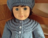 Blue knitted sweater, hat and fingerless gloves for the American Girl doll.