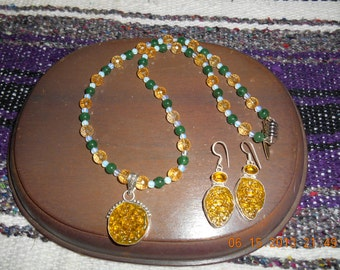 Citrine and motivate pendant on necklace and earrings