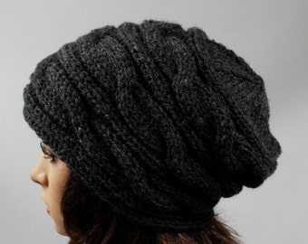 Hand knitted ladies slouchy beanie. A lovely hat available in many colours.