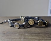 Bullet Jewelry - Silver Bullet .45 Caliber Shell Casing Adjustable Macrame Bracelet