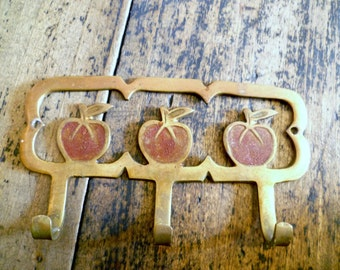 Vintage French Kitsch Coat Hook kitchen hook or Tea Towel Hanger Three Red Apples in Brass C.1950