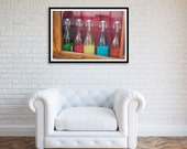 Fine art print of colorful class bottles displayed in a shop window in Paris France.