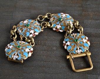 ANTIQUE EDWARDIAN Gilt brass and enamel multicross bracelet.