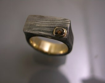 Damascus band lined in 14k yellow gold with .34 carat rose cut brown diamond