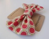 Dusky pink circle print hair bow with crocodile clip