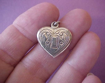 Unusual and Sweet Little Sterling Silver Heart Shaped Charm with Engravings