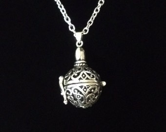 Silver hollow ornate prayer ball opening locket sphere necklace