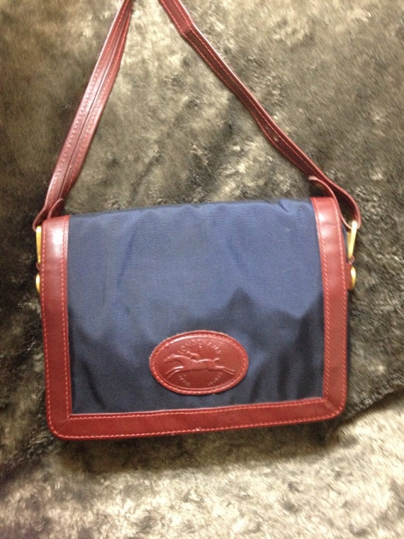 Vintage Longchamp navy nylon and wine red leather trimming shoulder purse. Original zipper. Unisex bag for daily use
